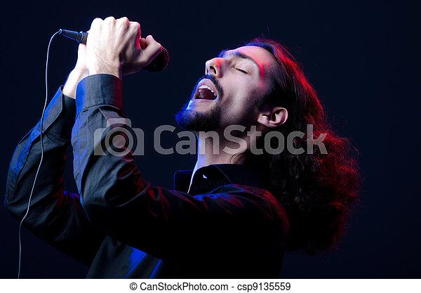 Man singing at the concert - csp9135559