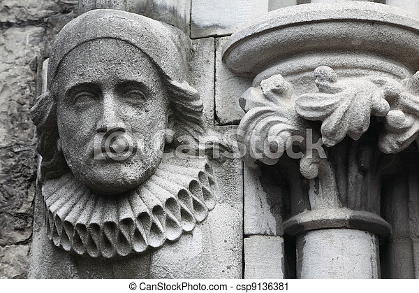 old bas-relief made of stone in Christian Church, melancholy face - csp9136381