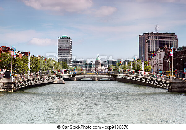 Ha'penny Bridge is pedestrian bridge built in 1816 over River Liffey in Dublin, Ireland - csp9136670