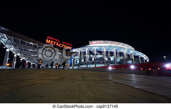 MOSCOW - MARCH 28: Palace of Sports Megasport, people at night on March 28, 2010 in Moscow, Russia. Form of buildings reminiscent screw - cylindrical volume with diameter of 120 m and height of 40 m - csp9137145
