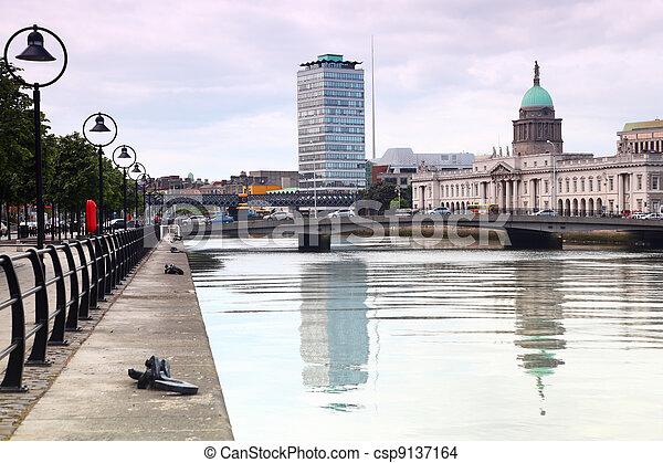 bridges near customs building, quay of river Liffey in Dublin, Ireland - csp9137164