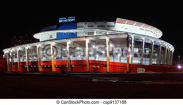 MOSCOW - MARCH 28: Palace of Sports Megasport at night on March 28, 2010 in Moscow, Russia. Form of buildings reminiscent screw - cylindrical volume with diameter of 120 m and height of 40 m - csp9137188
