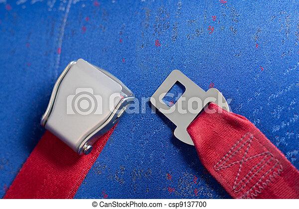 Unlocked seat belt lays on the chair. - csp9137700