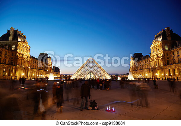PARIS - JANUARY 1: View on the Louvre pyramid from the inner courtyard side, January 1, 2010, Paris, France. The pyramid is surrounded by fountains and three pyramids less size. - csp9138084