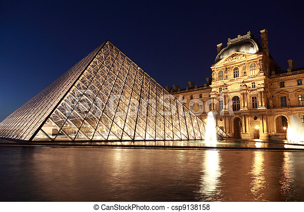 PARIS - JANUARY 1: View on the Louvre Pyramid and Pavillon Rishelieu in the evening, January 1, 2010, Paris, France. Pyramid weight — about 180 tons. - csp9138158