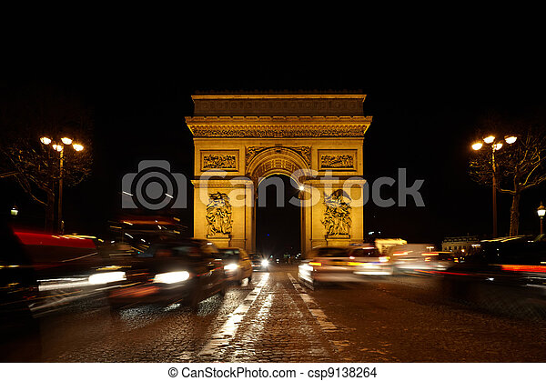 Triumphal Arch on the SDG square at night. Road out of focus. Blurred lighting traces of automobiles. - csp9138264