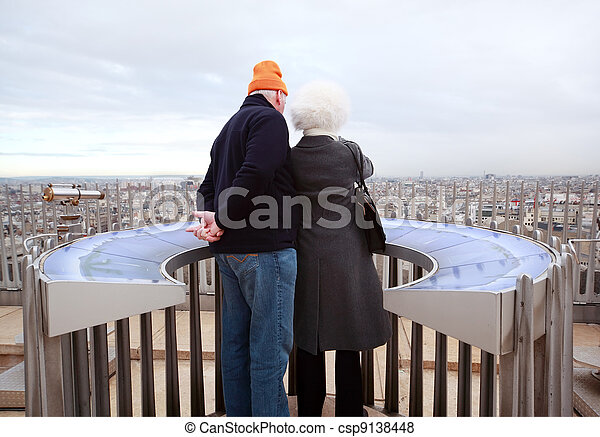 PARIS - JANUARY  2: Couple stands on Arc de Triomphe on January 2, 2010 in Paris, France. Annually Paris visits 20 million tourists. - csp9138448