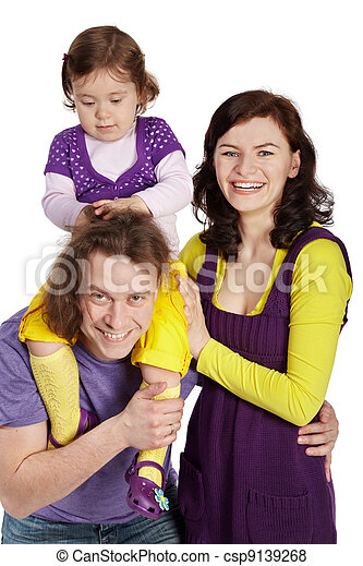 Father, mother and little daughter, daughter sits on father's shoulders and ruffles his hair. - csp9139268