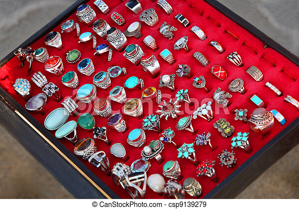few rows of souvenir large rings on red backing. sale. wide range. bijouterie - csp9139279