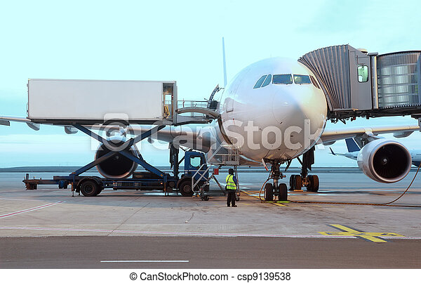 airliner parked at airport. boarding passengers. service technician - csp9139538