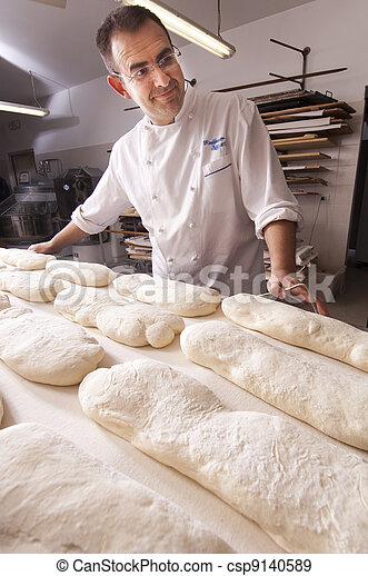 Baker makes the bread - csp9140589