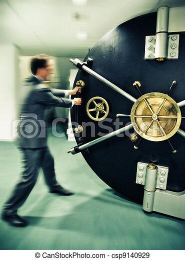 banker is opening safe door - csp9140929