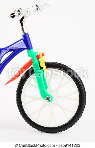 front of colorful plastic toy two-wheeled bicycle on white background - csp9141223