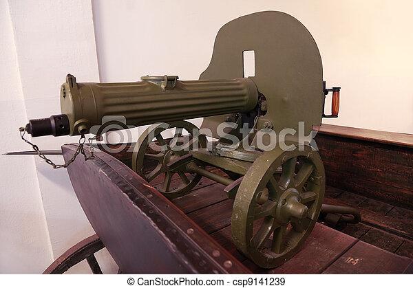 old Soviet green gun stands on wooden cart; weapons since World War II - csp9141239