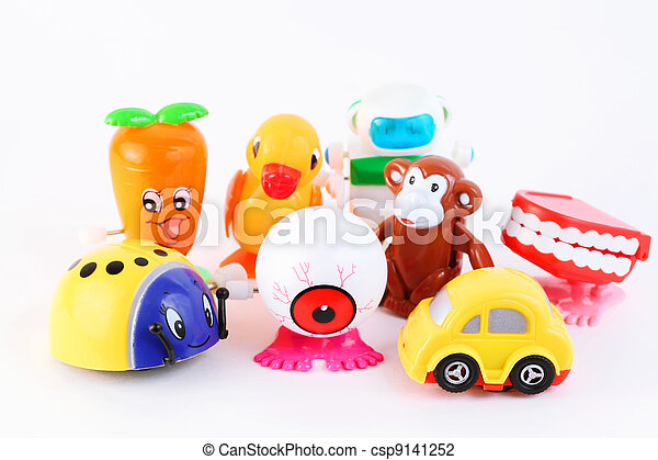 group of eight small bright clockwork toys on white background - csp9141252