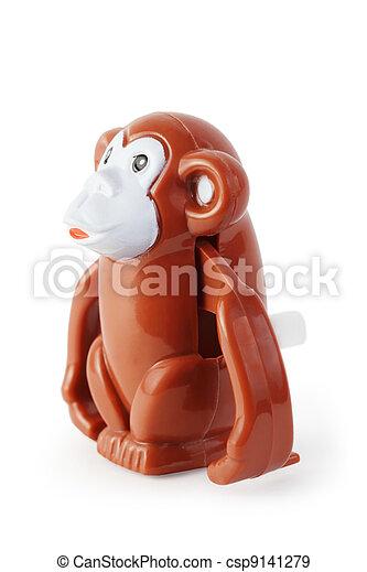 bright toy clockwork brown waggish monkey on white background - csp9141279