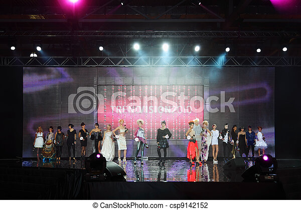 MOSCOW - OCTOBER 3: Models with beautiful hairdos stand on stage at Competition Wella Trend Vision Award 2010, on October 6, 2010 in Moscow, Russia. - csp9142152