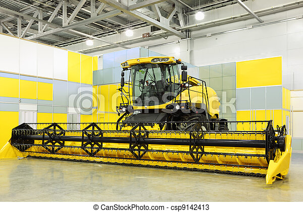 Big yellow harvester are in room at exhibition, special agricultural machine - csp9142413