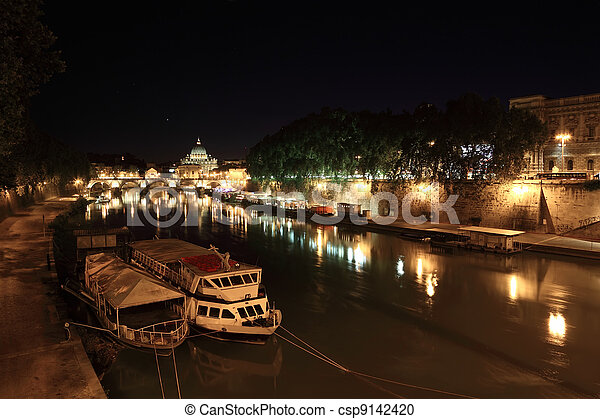 Boats on Tiber river, Sant' Angelo Bridge and Basilica of St. Peter at night in Rome, Italy - csp9142420