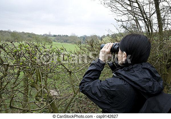 woman birdwatching - csp9142627
