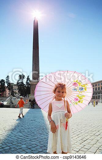 Little beautiful girl near obelisk on Piazza del Popolo in Rome, Italy - csp9143646