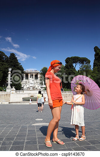 Young mother and little daughter standing on Piazza Popolo, nearh water flows from an ancient aqueduct Aqua Vergine, focus on mother - csp9143670