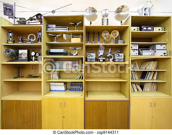 MOSCOW - OCTOBER 14: Closet with physical devices and books in school class on October 14, 2010 in Moscow, Russia. Basics of religion and secular ethics will be introduced in all Russian schools. - csp9144311