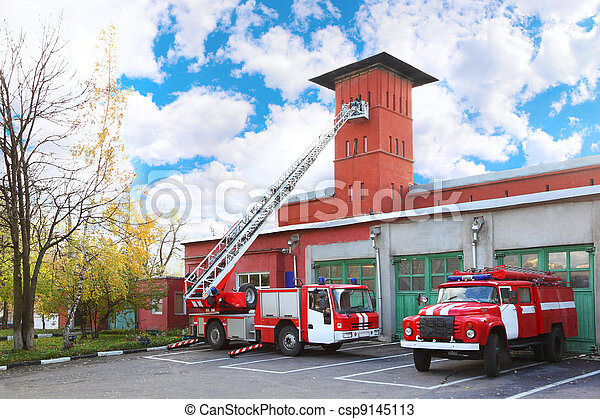 fire station, two red fire truck with long ladder, red high tower - csp9145113