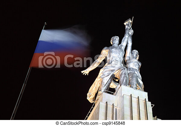Worker and Collective Farm monument in Moscow at night, hammer and sickle, russian flag - csp9145848