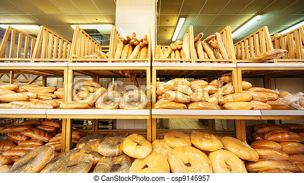 lots of fresh crisp loaves of bread on shelves in store; bread is one of main food - csp9145957