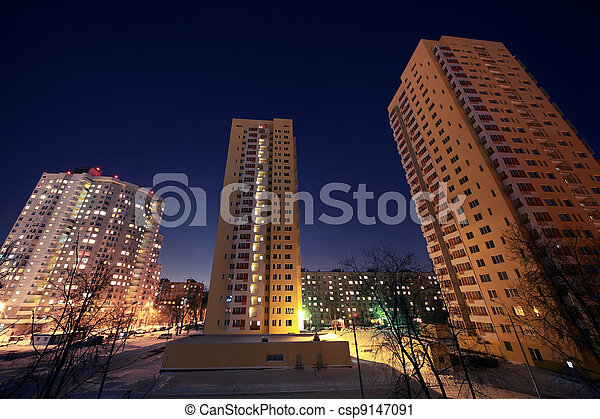 Dwelling district with skyscraper in evening in winter - csp9147091