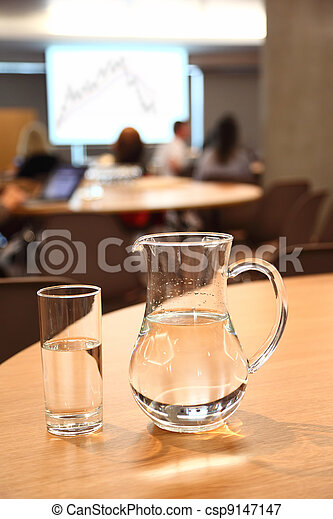 decanter and glass with clean clear water on light table in room - csp9147147
