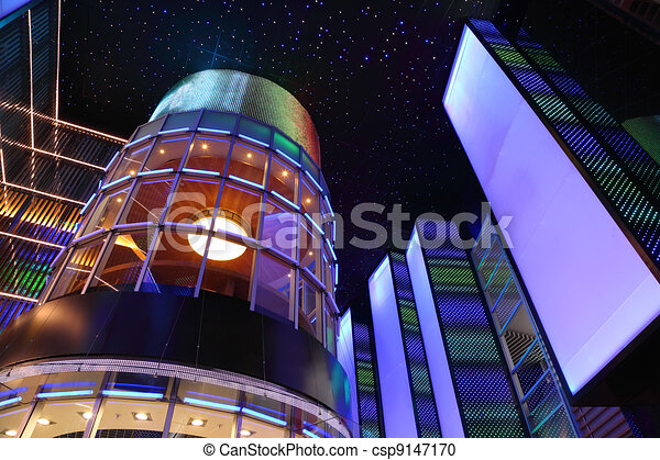 stylish interior of shopping center, dark ceiling with stars, colorful illumination - csp9147170