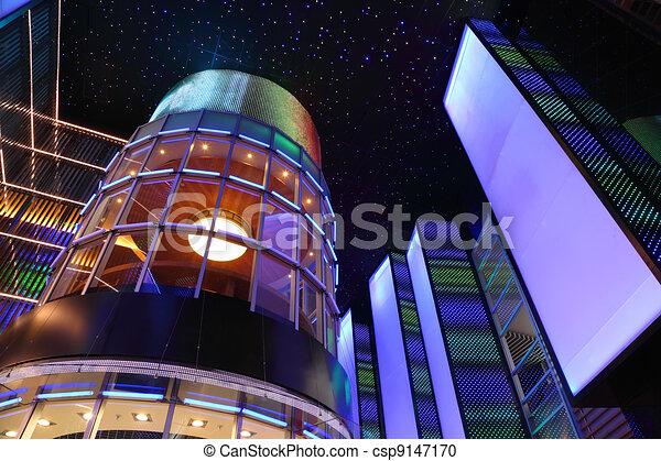 stylish interior of shopping center, dark ceiling with stars, colorful illumination - csp9147170