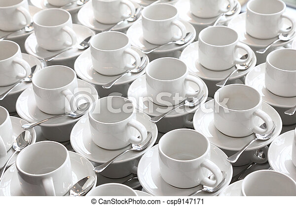 many rows of pure white cup and saucer with teaspoon, reflection on table - csp9147171