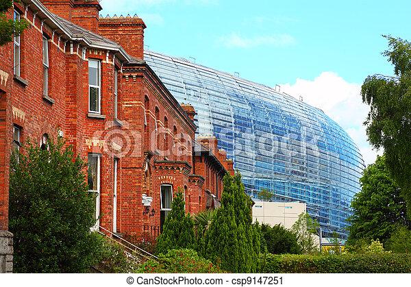 Stadium Aviva and red brick building at day in Dublin, Ireland - csp9147251