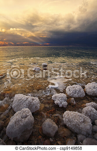 Coast of the Dead Sea in Israel in a spring thunder-storm. The coastal stones covered by salty adjournment - csp9149858