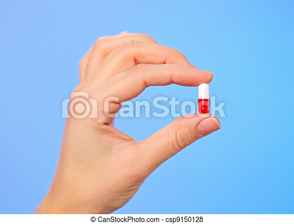 Red and white bolus (capsule) in doctor hand, macro view - csp9150128