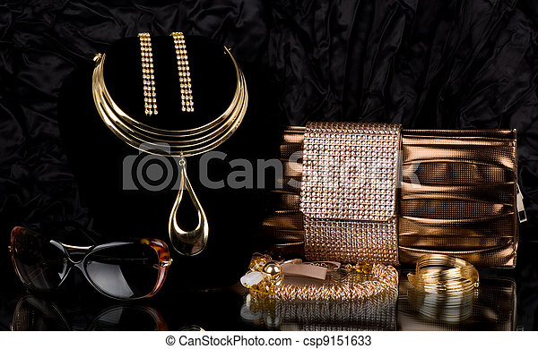 handbag and golden jewelry, glasses - csp9151633