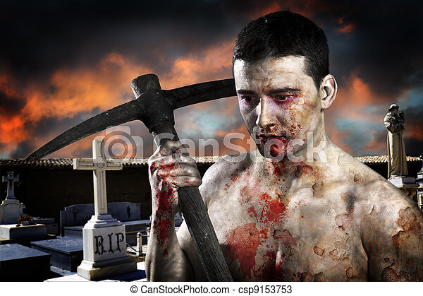 Male zombie in a cemetery, undertaker with pick axe - csp9153753