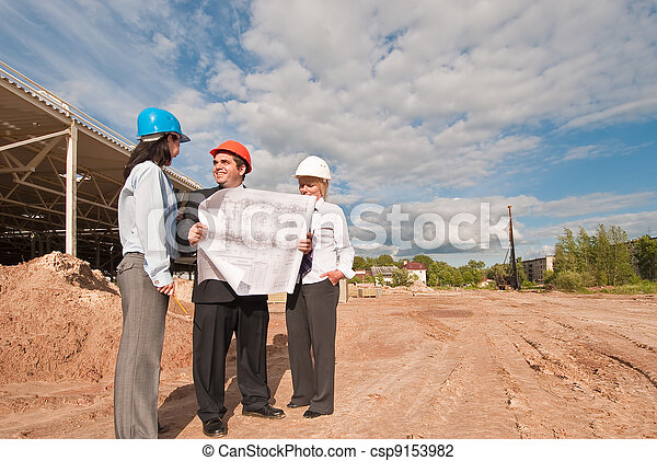 Director with subordinates on construction site of shopping cent - csp9153982