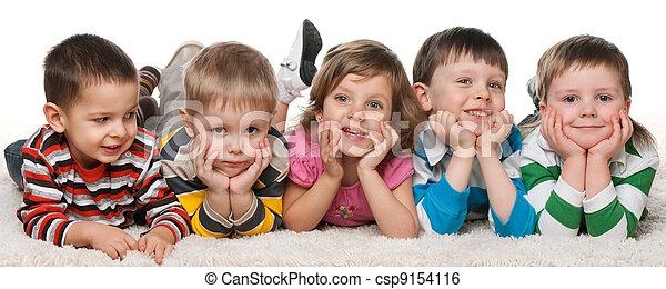 Five children lying on the carpet - csp9154116