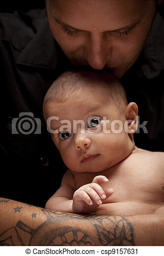 Young Father Holding His Mixed Race Newborn Baby - csp9157631