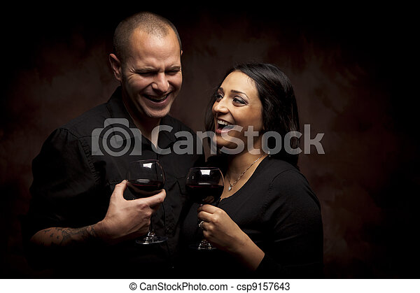 Happy Mixed Race Couple Holding Wine Glasses - csp9157643