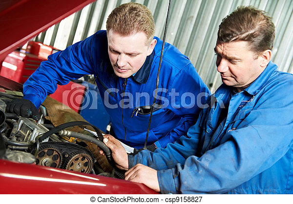 two car mechanic diagnosing auto engine problem - csp9158827