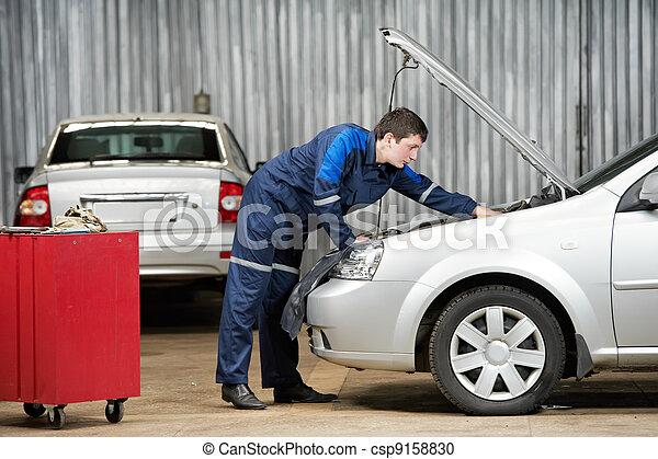 car mechanic diagnosing auto engine problem - csp9158830