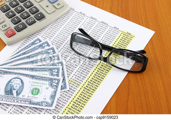 Eye glasses on accounting table. - csp9159023