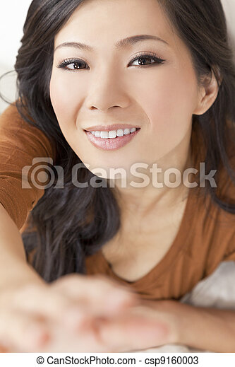 Beautiful Young Asian Chinese Woman Reaching To Camera - csp9160003
