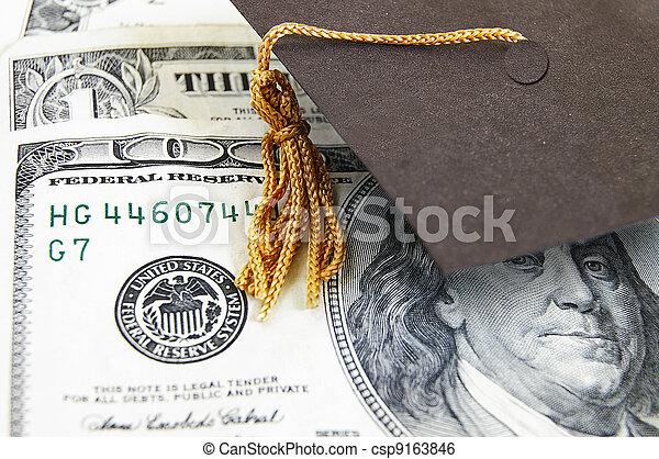 mini graduation cap on money - csp9163846