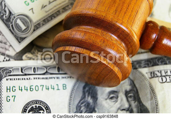 closeup of a gavel on cash, from above - csp9163848